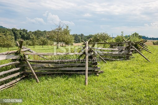 A split-rail fence or Worm fence (also known as a zigzag fence or snake fence) on the Gettysburg Pennsylvania battlefield.