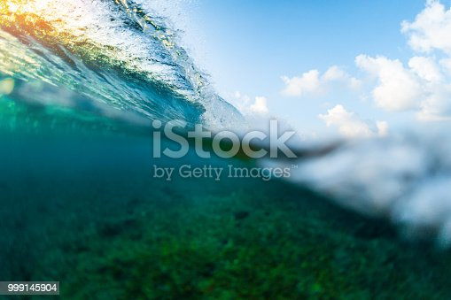 Splitted image of the ocean wave breaking over coral reef