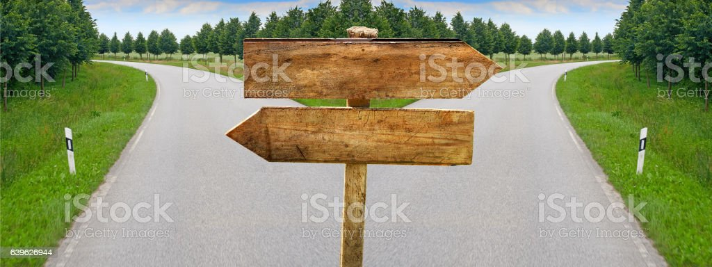 Splitting road blank crossroad wooden blabk signs stock photo