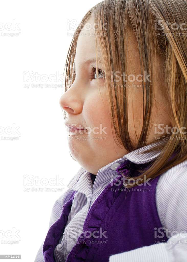 Spoiled little girl is looking at someone royalty-free stock photo