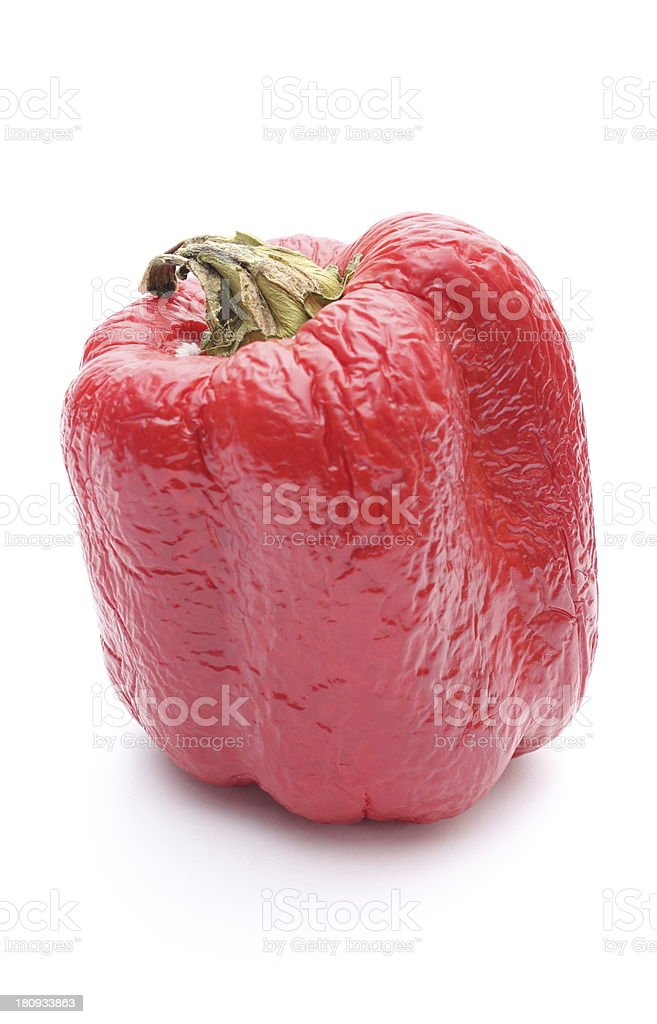 Spoiled peppers on white background royalty-free stock photo