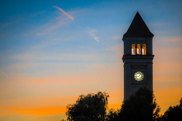 spokane downtown clock tower in park at sunset stock photo