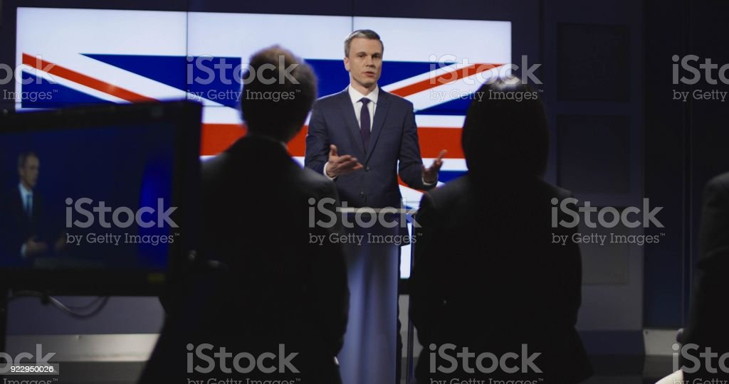 Spokesman conducting conference on behalf of country stock photo