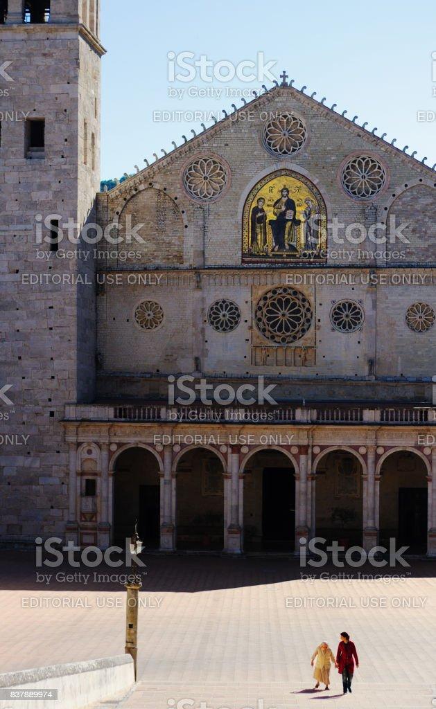 Spoleto, Umbria, Italy: Cathedral Facade; Senior Nun in White Habit stock photo