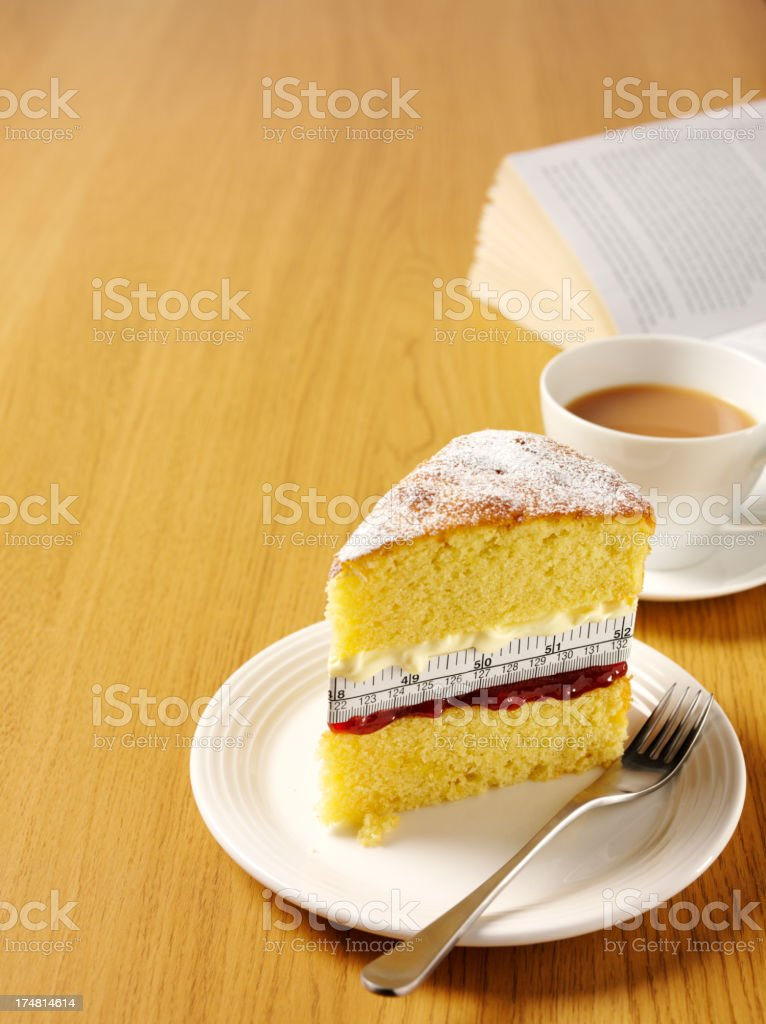 Sponge Cake Filled with Cream, Jam and Tape Measure stock photo