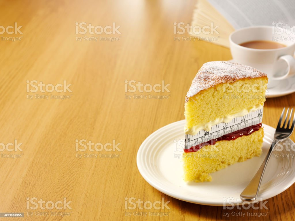 Sponge Cake with a Tape Measure for Weight Watchers stock photo