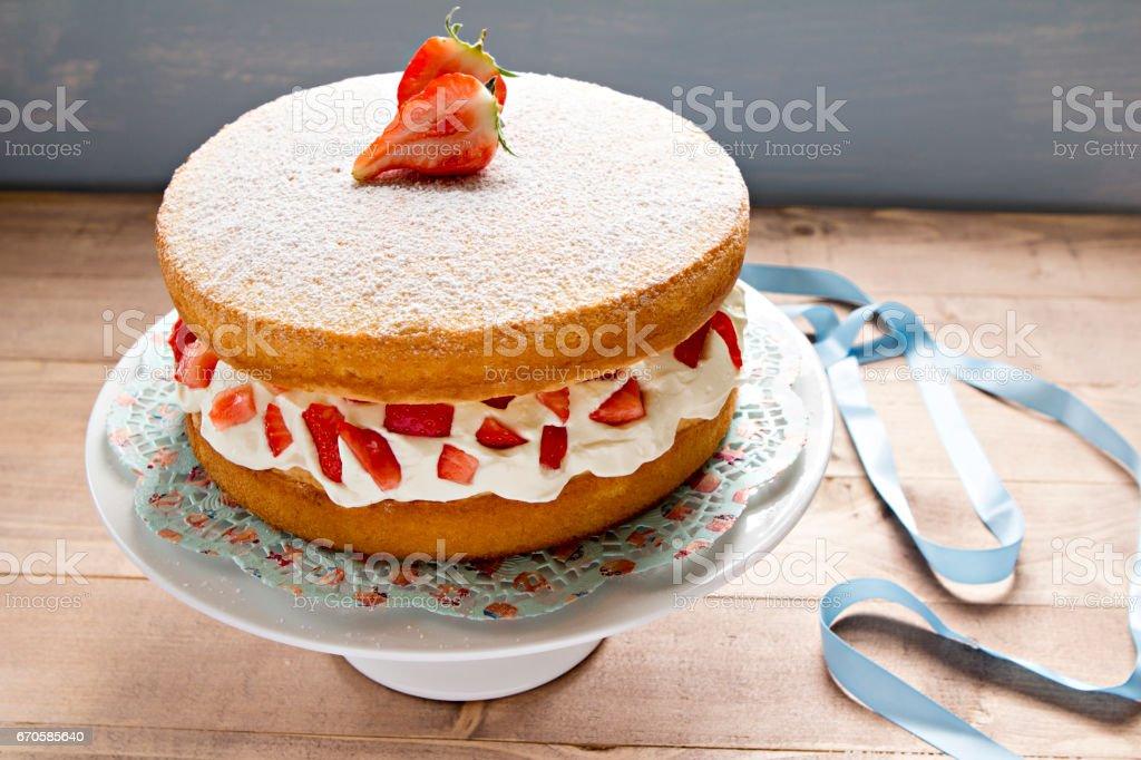 Sponge cake with cream and strawberries stock photo