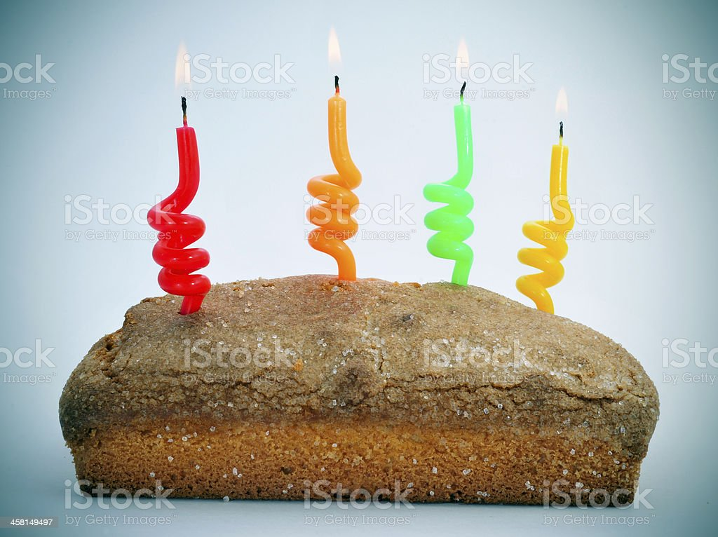 sponge cake with lighted candles foto