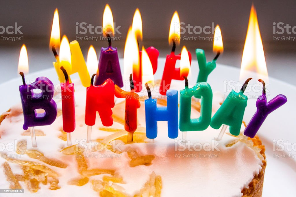 Sponge Cake With Lite Happy Birthday Candles