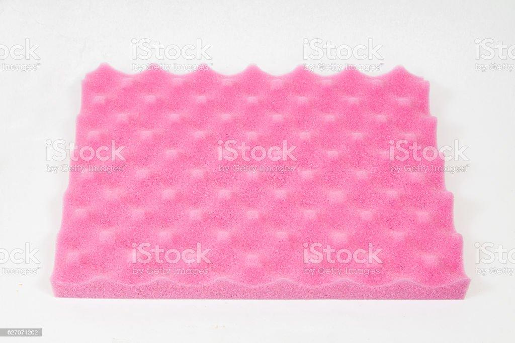 Sponge cushioning pink color on white background stock photo