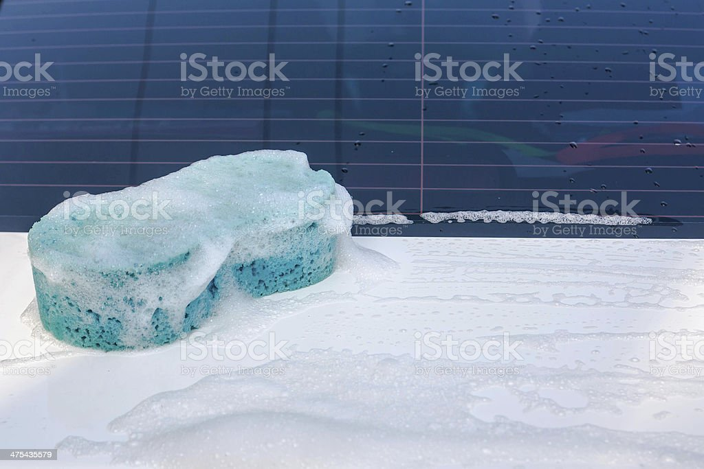 sponge over the car for washing royalty-free stock photo