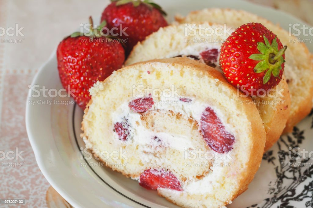 Sponge roulades with cream and fresh strawberries, close-up stock photo