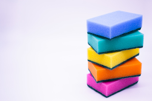 istock Sponges for washing dishes, on a white background, isolated. Colorful multi-colored as rainbow sponges lay one each other. Copy space 1214689172