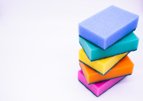 istock Sponges for washing dishes, on a white background, isolated. Colorful multi-colored as rainbow sponges lay one each other. Copy space 1214689198