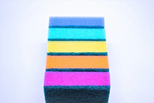 istock Sponges for washing dishes, on a white background, isolated. Colorful multi-colored as rainbow sponges lay one each other. Copy space 1214692913