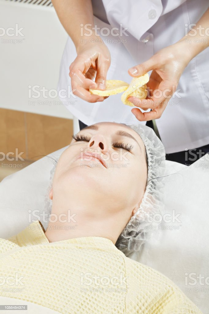 Sponges over face stock photo