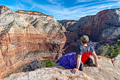 This is the picture of a hiker in subway trail in Zion National Park, Utah, USA