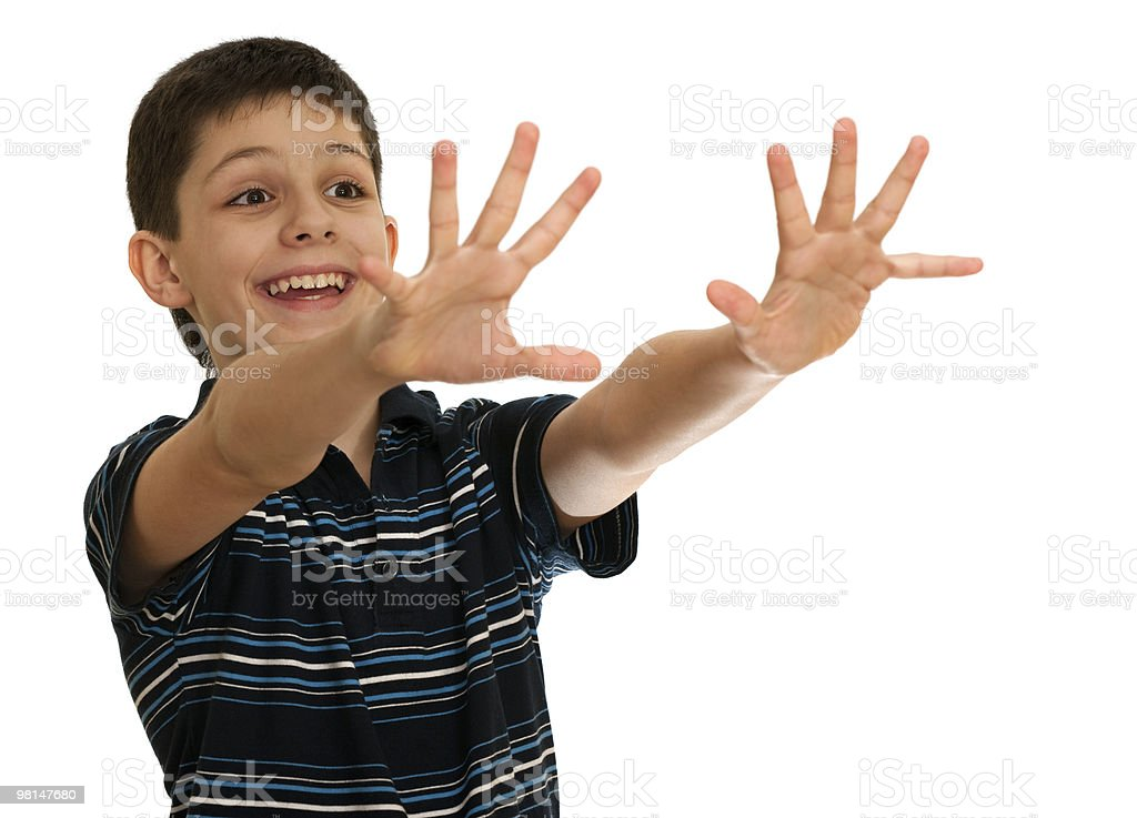 Spontaneous boy is stretching his hands towards an invisible aim royalty-free stock photo