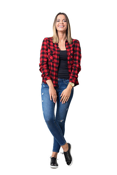 spontaneously laughing relaxed young pretty casual woman in jeans - modisch leger frauen stock-fotos und bilder