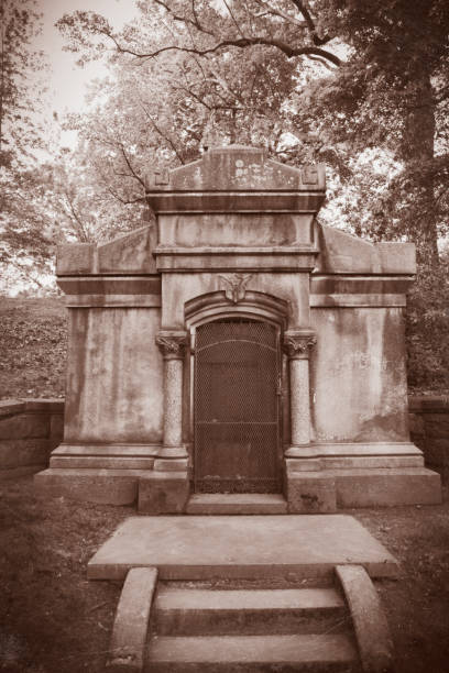 """Spooky 1800s Mausoleum A creepy, nameless mausoleum built into a hillside from the 1800's- urban legend nicknamed """"The Vampire Crypt."""" sdominick stock pictures, royalty-free photos & images"""