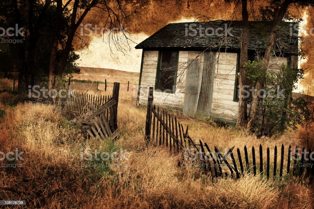 Spooky, Abandoned House Overlayed with Dirty, Old Paper royalty-free stock photo