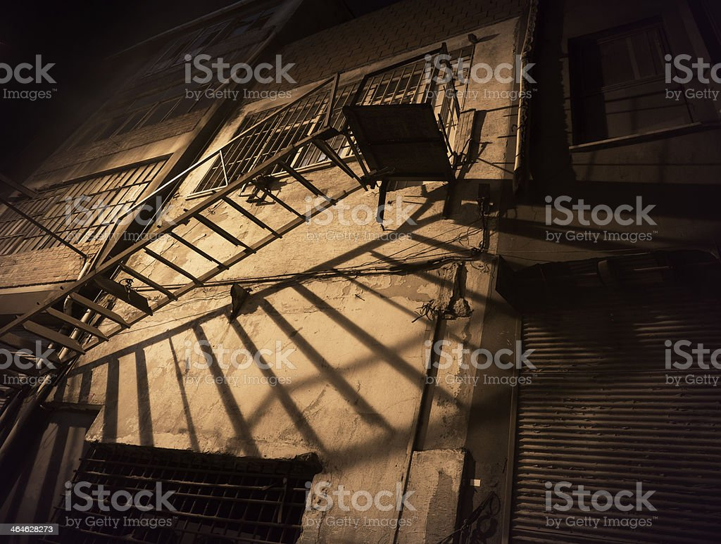 Spooky back yard with fire escape stock photo