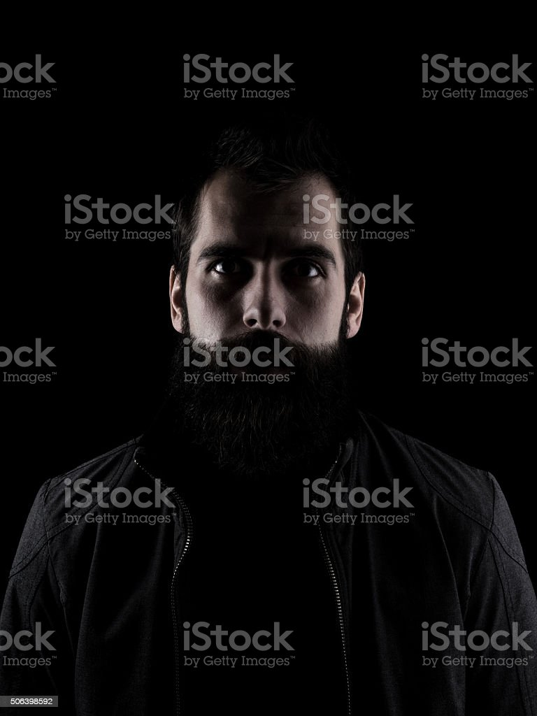 Spooky bearded man staring at camera stock photo