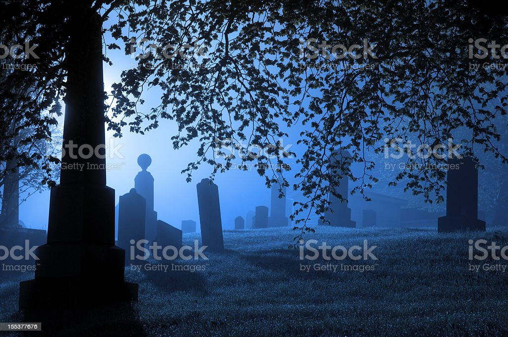 Spooky blue graveyard stock photo