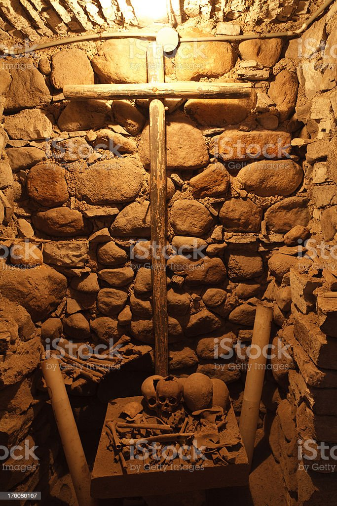 Spooky Bones in Ancient Crypt royalty-free stock photo