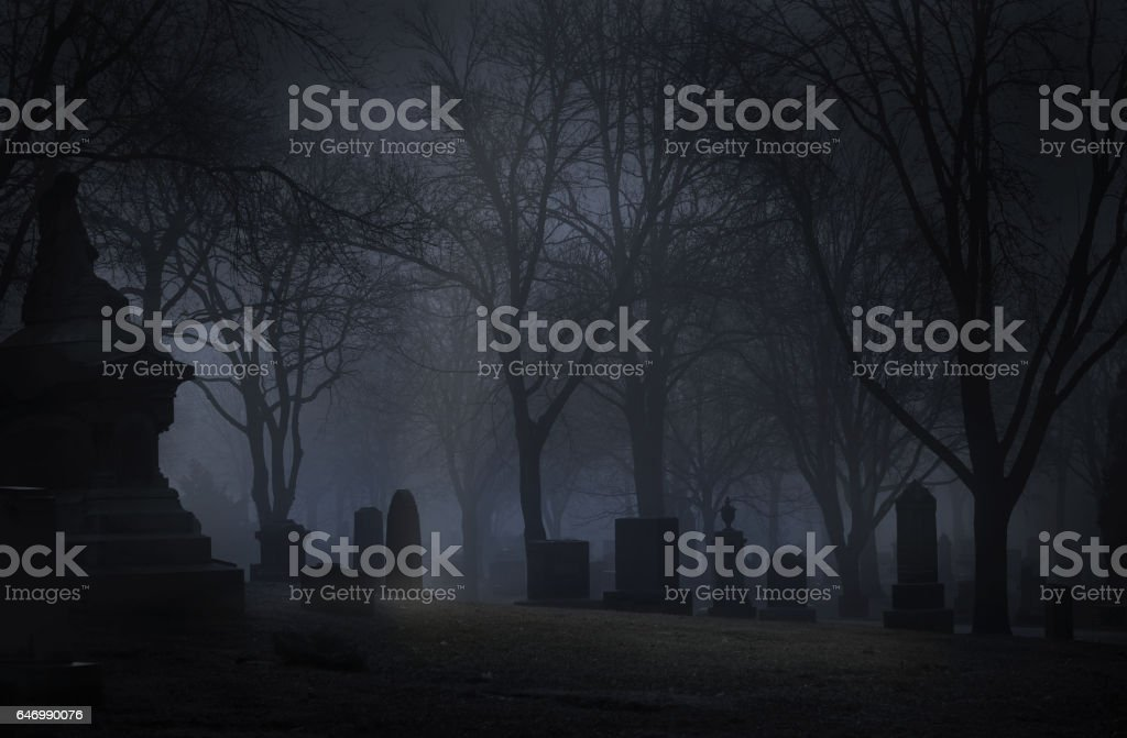 Spooky Cemetery at night with fog stock photo
