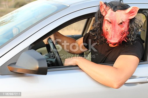486524205 istock photo Spooky creature driving a car 1182697211