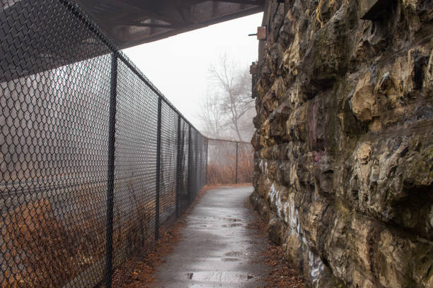 Spooky Fenced Off Path stock photo