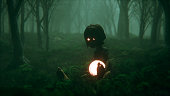 Spooky foggy forest with kid and his magic ball