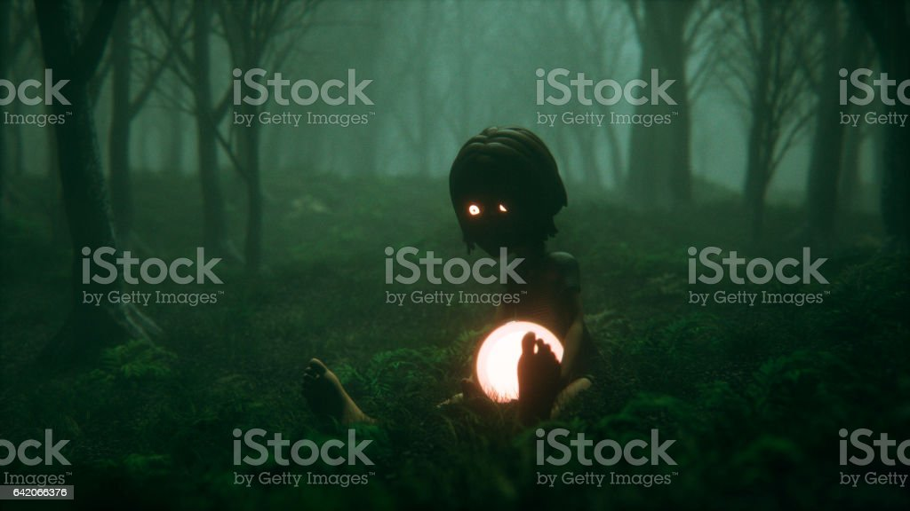 Spooky foggy forest with kid and his magic ball stock photo