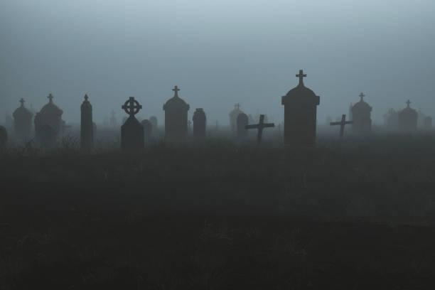 Spooky graveyard at night stock photo