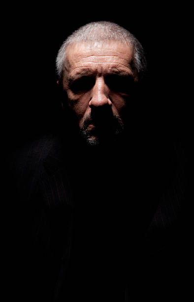 Spooky grey haired mature man stock photo