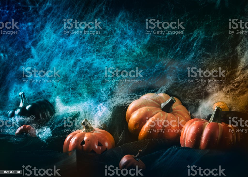 Spooky Halloween Background With Cobweb Spiders And Pumpkin