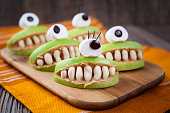 Spooky halloween edible apple monsters healthy natural dessert. Horror party
