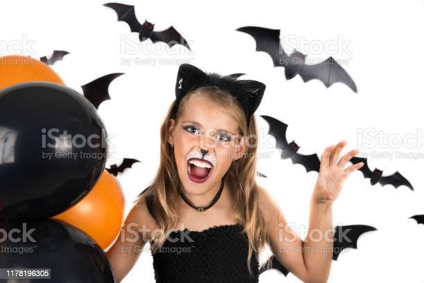 Spooky halloween girl with halloween costume of a black cat dressed picture id1178196305?b=1&k=6&m=1178196305&s=612x612&h=oruwmjcpphdcrdoynmoxa4dmhlikpnww3foxj0 ejq4=