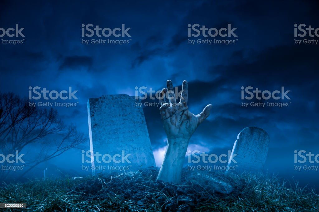 Spooky Halloween Graveyard Night Zombie Hand From The Grave stock photo