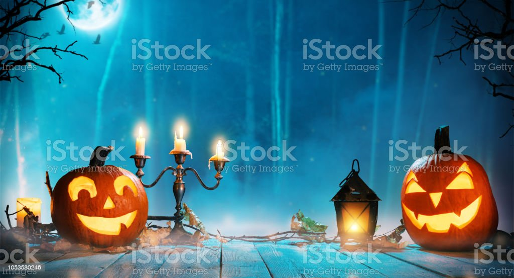 Spooky halloween pumpkins in forest stock photo