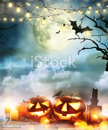 istock Spooky halloween pumpkins on wooden planks 1026097344