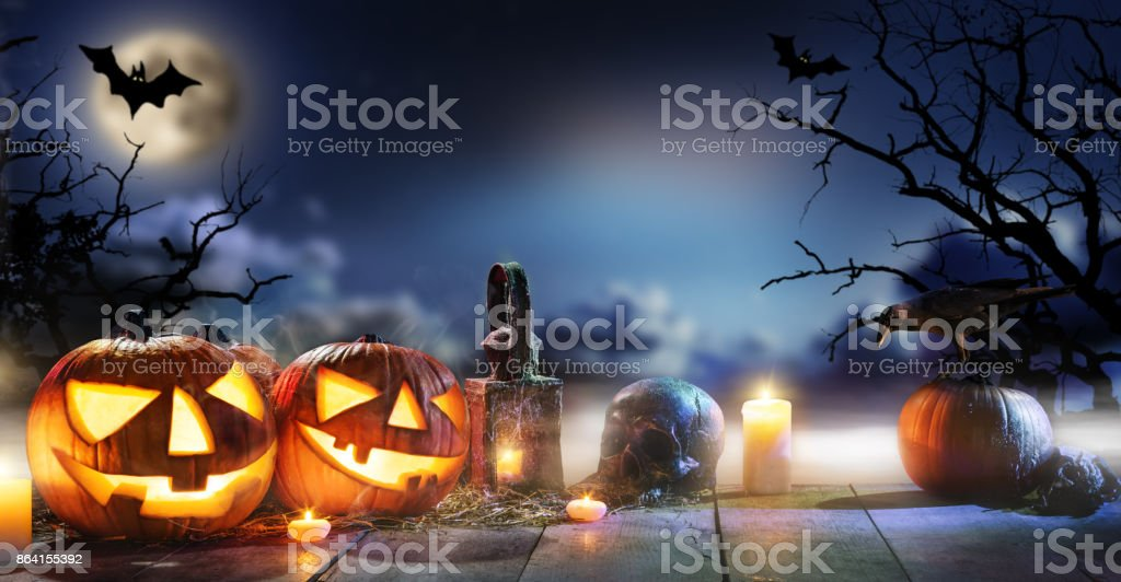 Spooky halloween pumpkins on wooden planks royalty-free stock photo