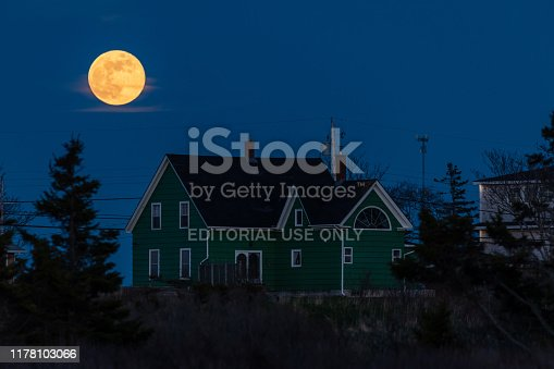 Lunenburg, Nova Scotia, Canada - May 19, 2019: A lonely house with full Moon in the night