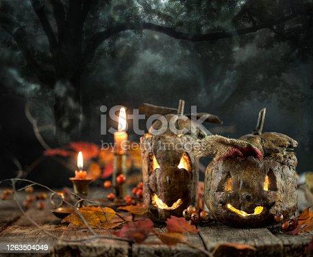 Spooky Jack o' lanterns on a black background