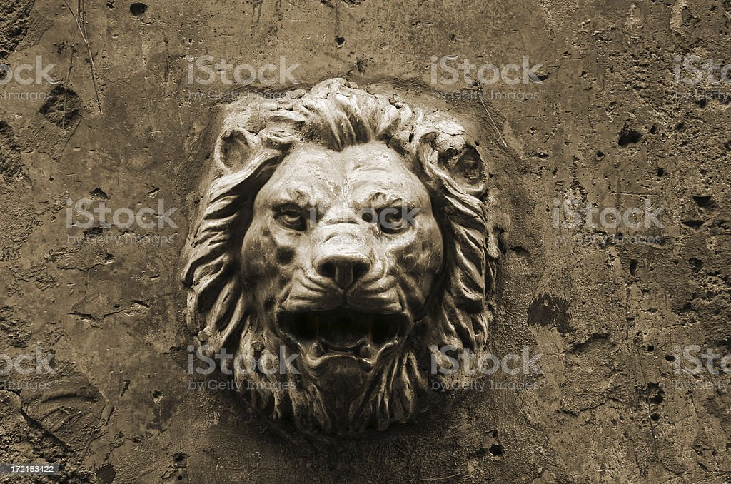 Spooky lion head decoration on a Roman wall, Rome Italy royalty-free stock photo