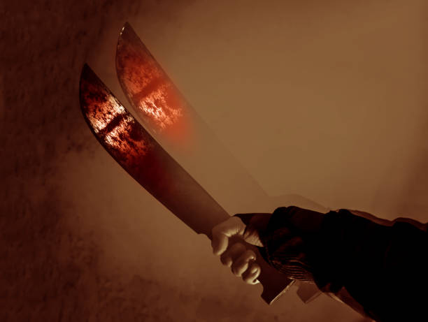 spooky machete digital composite sepia tone image of hand with scary machete with red blade reflection in the dark mass murder stock pictures, royalty-free photos & images