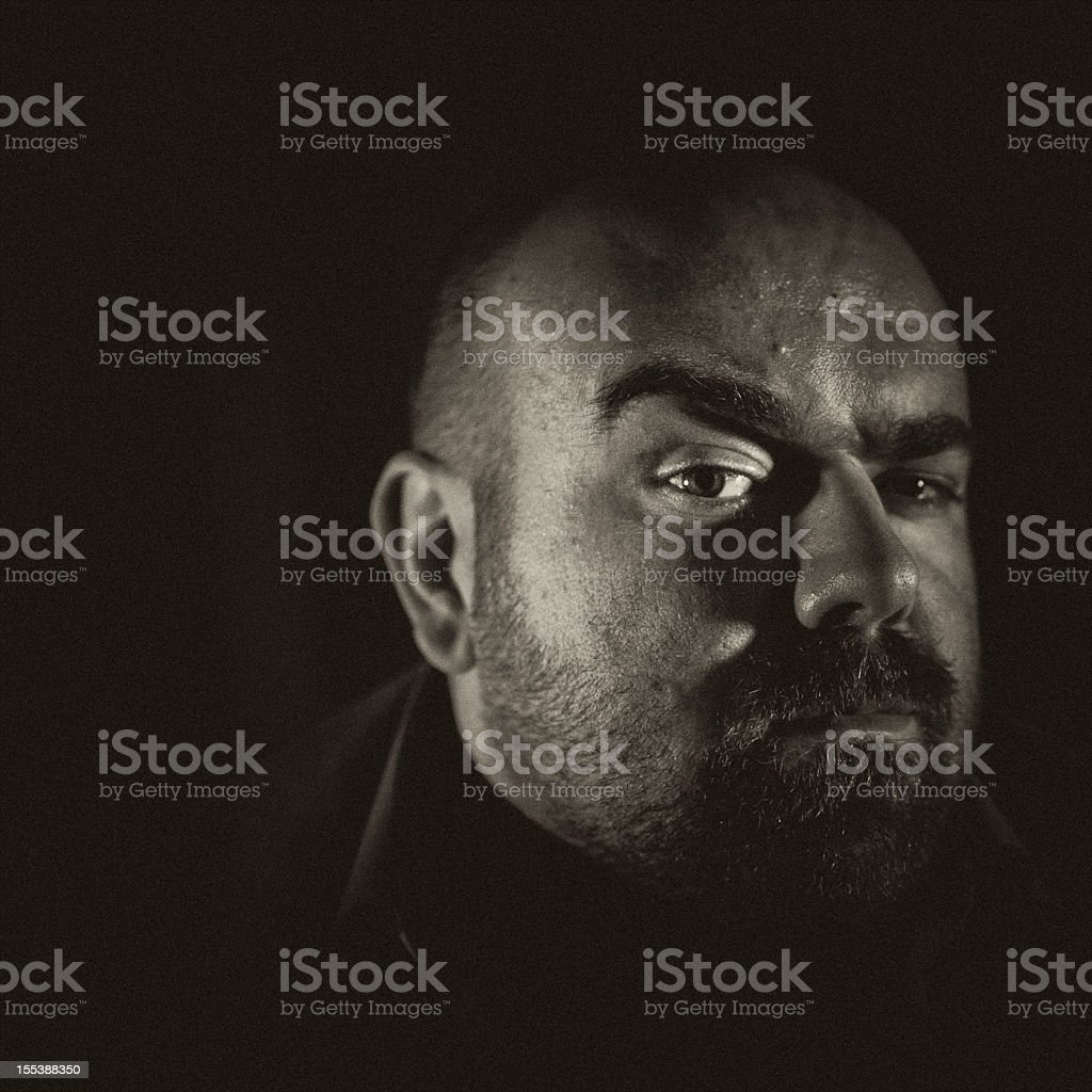 spooky mad bald guy with raised eyebrows stock photo