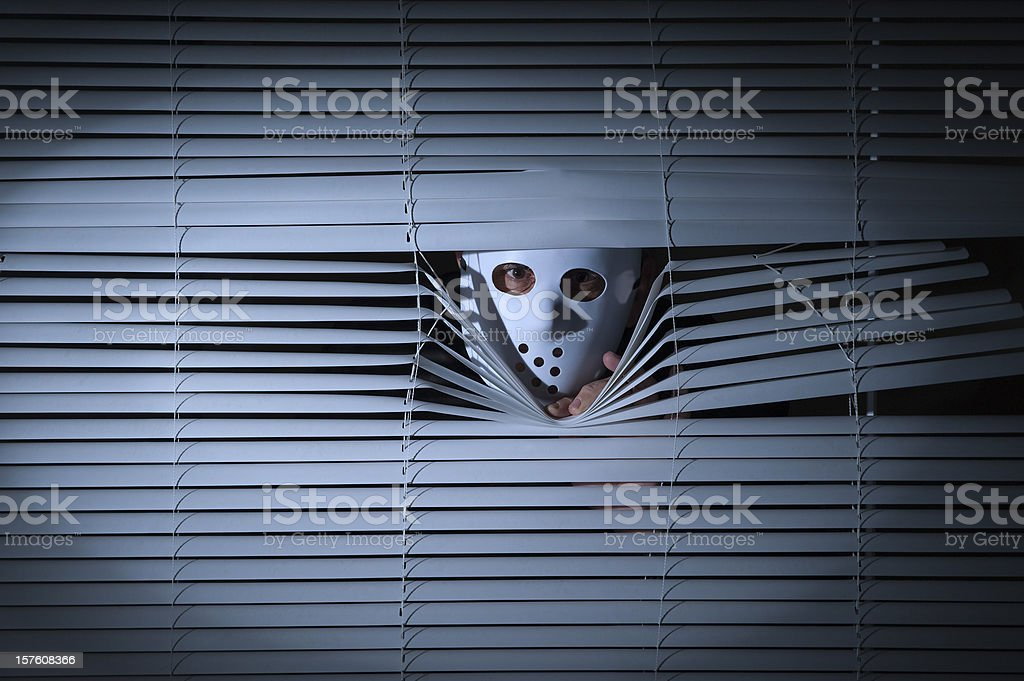 Spooky men behind blinds stock photo