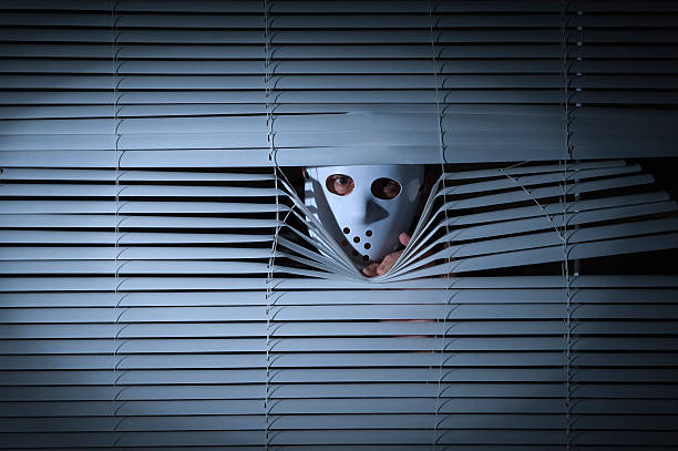 Spooky men behind blinds Spooky men with mask behind blinds. creepy stalker stock pictures, royalty-free photos & images